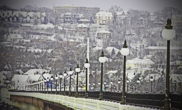 This is a shot of the High Bridge is St Paul, MN. In the lower left corner is a little blue house...